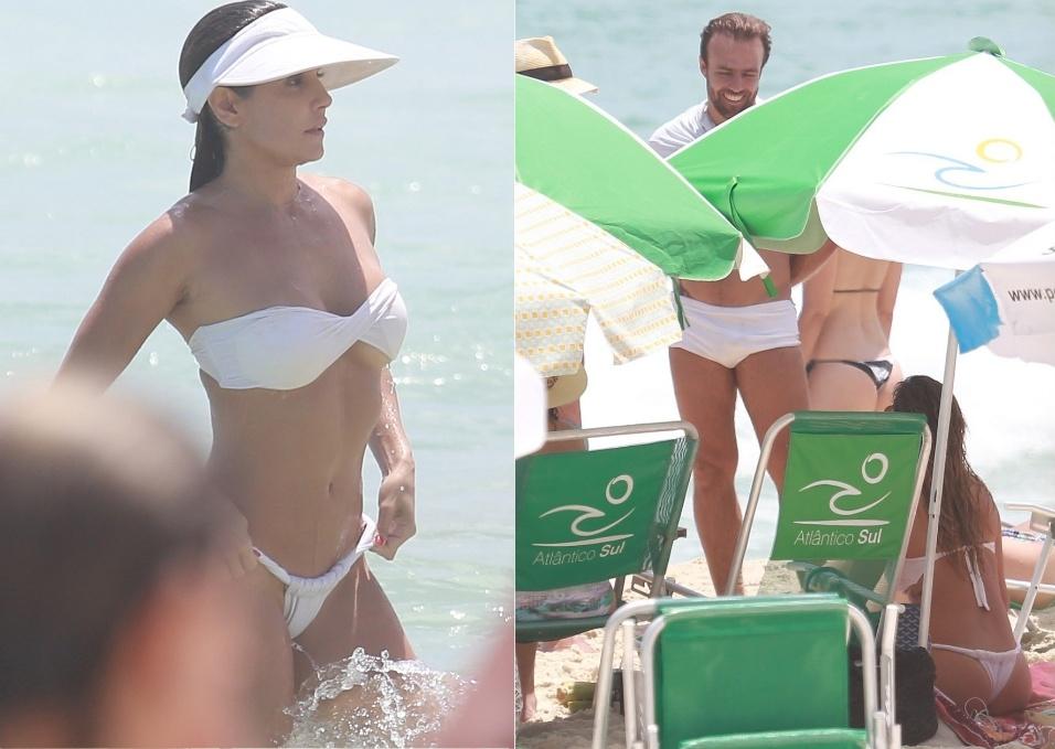 31.dez.2014 - Deborah Secco aproveitou o calor do Rio de Janeiro para curtir uma praia na Barra da Tijuca. Após alguns mergulhos, a atriz acabou encontrando o seu ex-marido, Roger Flores. Os dois conversaram amigavelmente na beira da praia