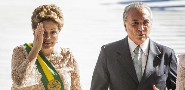 1º.jan.2015 - Na imagem, a presidente da República reeleita pelo PT, Dilma Rousseff, ao lado do vice-presidente Michel Temer (PMDB), durante cerimônia de posse, no Palácio do Planalto, em Brasília