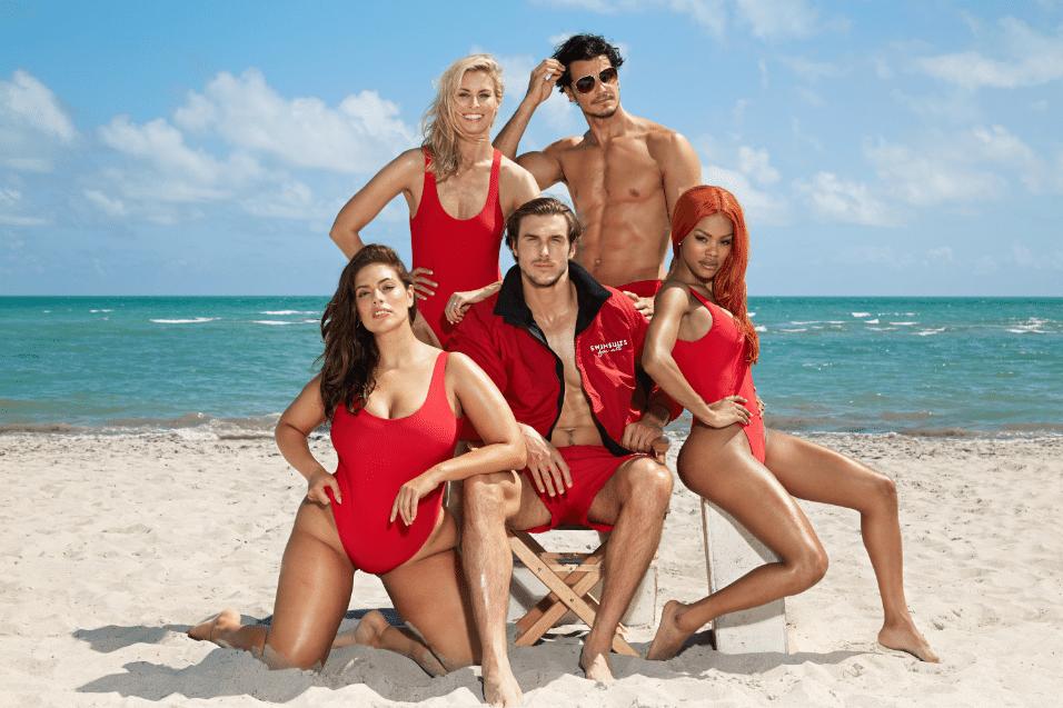 """19.mai.2017 - Ashley Graham (esq), Nick Taylor (de pé, esq.) e Teyana Taylor (dir.) posam como os salva-vidas da série """"SOS Malibu"""""""