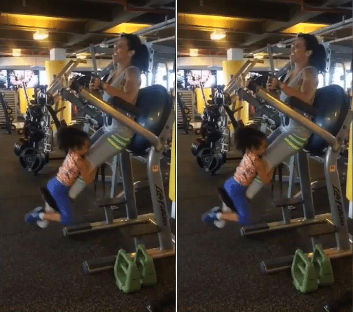 14.jan.2016 - Scheila Carvalho fez caras e bocas para continuar a série de exercícios com a ajuda da filha Giulia