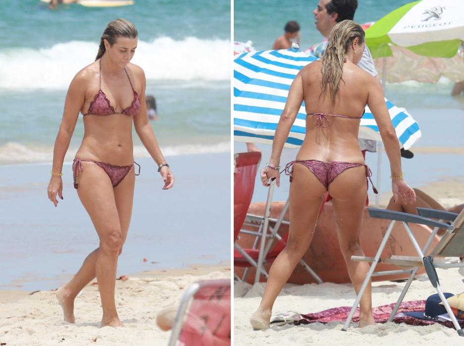 5.fev.2017 - Após mergulho no mar, Christine Fernandes descansa na praia da Barra da Tijuca