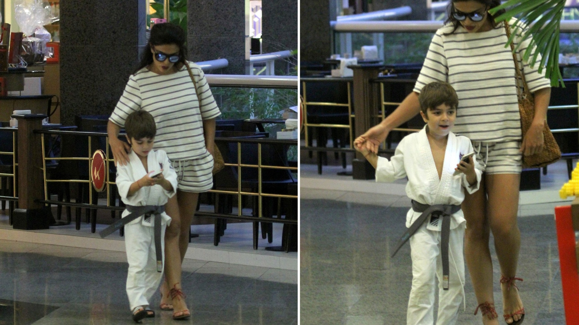 14.mar.2016 - Juliana Paes acompanha o filho Pedro, que não tira os olhos do celular, em shopping no Rio de Janeiro