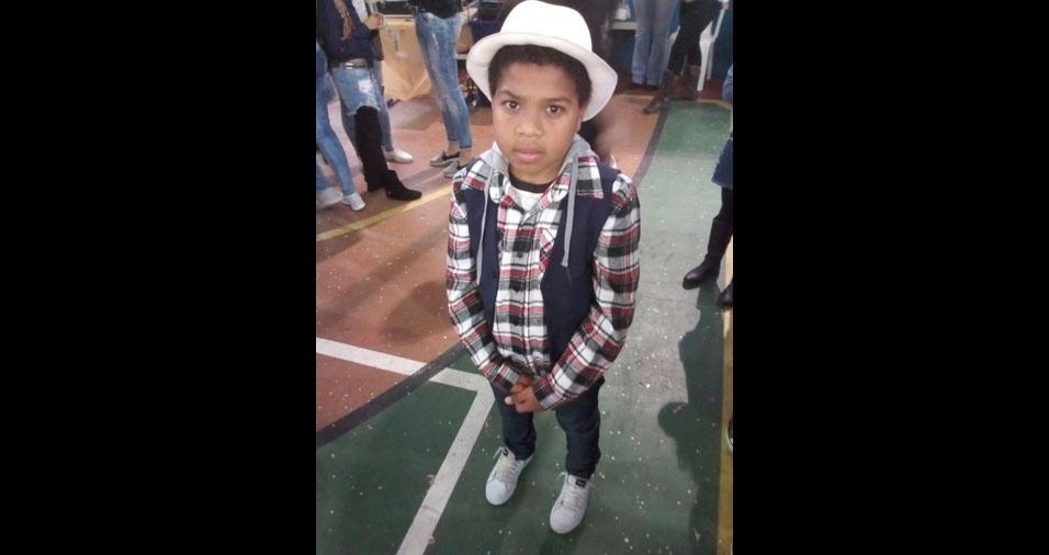 Rogerio de Jesus Coelho, de São Paulo (SP), participa do especial com foto do filho Matheus dos Santos Coelho, nove anos