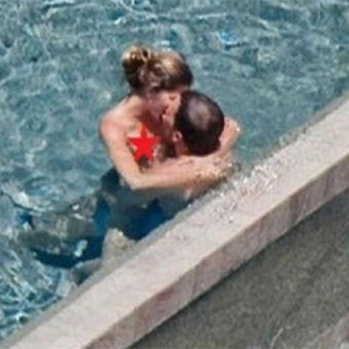 12.ago.2017 - Nem sempre a tecnologia vem para o bem, e Gisele Bündchen acaba de sentir isso na pele. Ela foi flagrada por um drone namorando o marido, Tom Brady, na piscina de sua mansão em Boston. A top estava só com a parte de baixo do biquíni e sentada no colo do atleta.