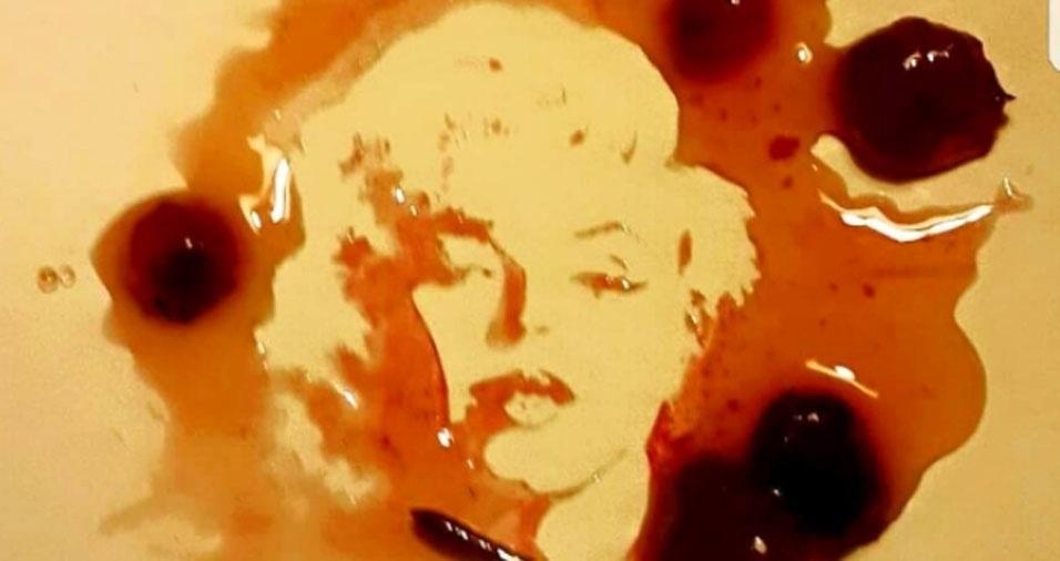 10. Pintura de Marilyn Monroe feita em uma mancha de geleia de morango