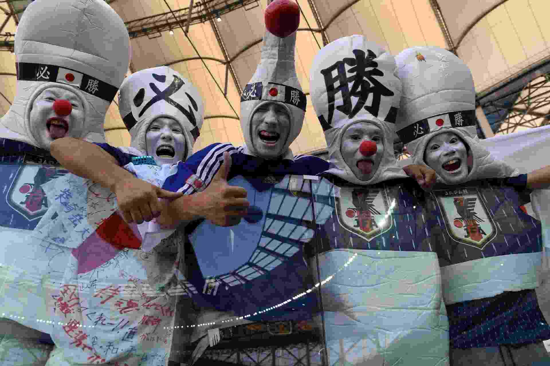 Torcida do Japão apoia seleção para duelo contra a Polônia - AFP
