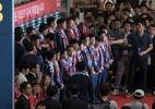 Jogadores da Coreia do Sul são recebidos com ovos na volta para casa - AFP PHOTO / Ed JONES