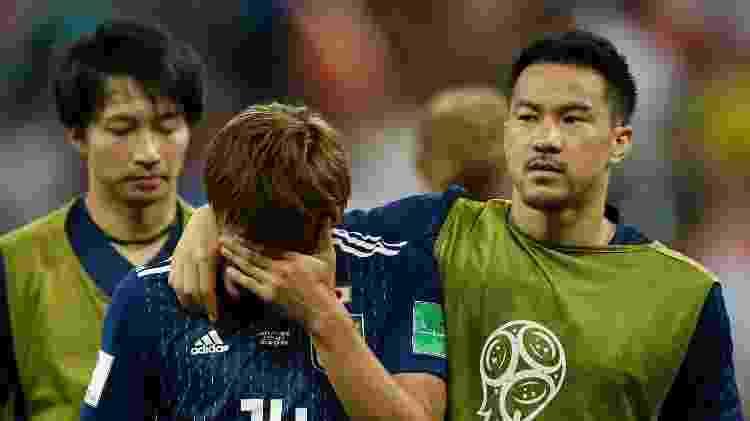 Inui e Okazaki, do Japão, após eliminação na Copa do Mundo - Odd Andersen/AFP - Odd Andersen/AFP