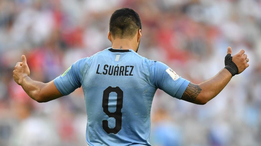 Luis Suárez foi um dos destaques do Uruguai na primeira fase da Copa - AFP PHOTO / Fabrice COFFRINI