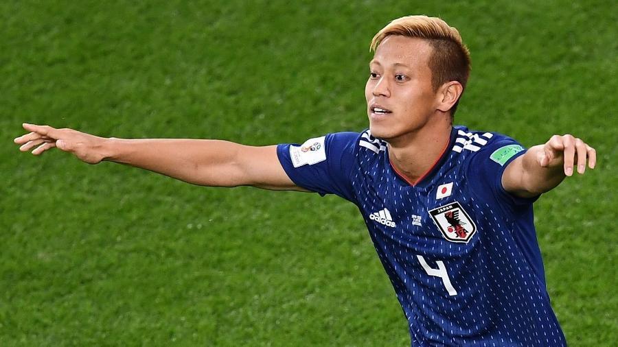 Honda comemora gol marcado pelo Japão contra o Senegal na Copa do Mundo - Anne-Christine Poujoulat/AFP