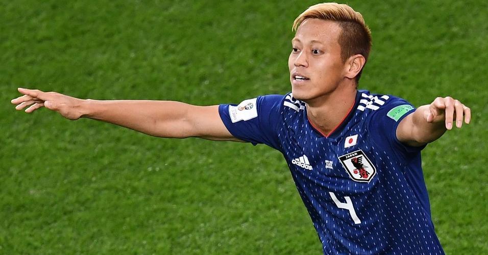 Honda comemora gol marcado pelo Japão contra o Senegal na Copa do Mundo