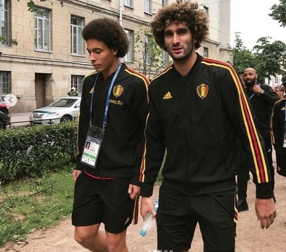 Jogadores belgas caminham antes de duelo semifinal contra França