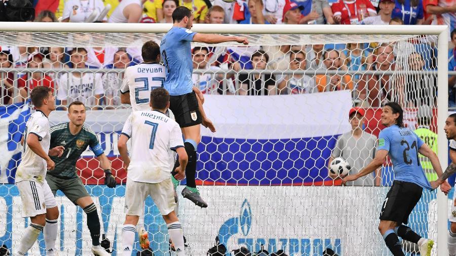O zagueiro Diego Godin é o capitão do time e o grande pilar do sistema defensivo uruguaio  - AFP PHOTO / EMMANUEL DUNAND