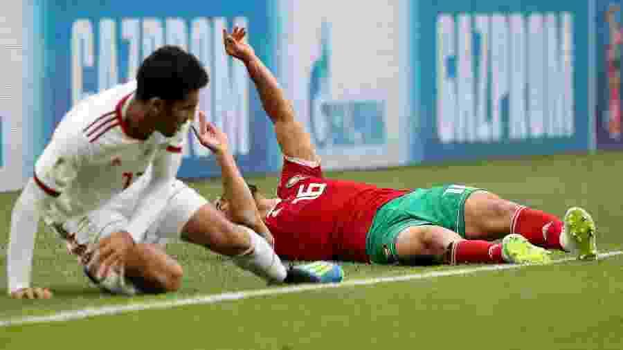 Copa do Mundo 2018  Jogador do Marrocos desmaia após dividida e é ... bf6e55eb7d3a3