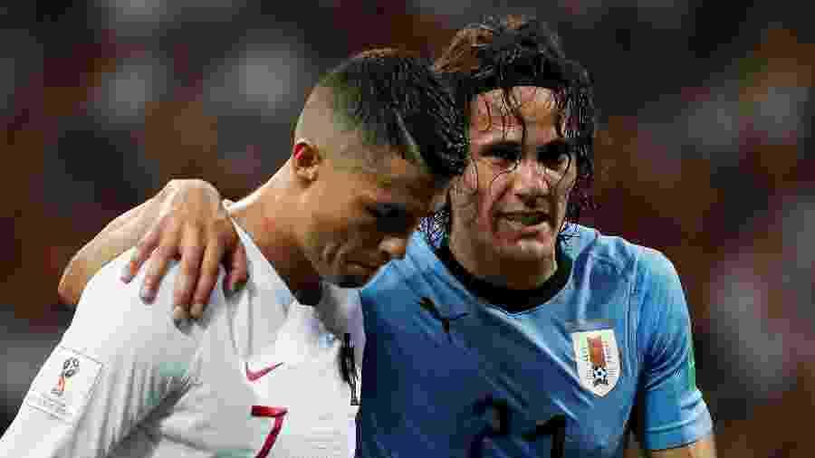 Cavani, do Uruguai, sai de campo com a ajuda de Cristiano Ronaldo, de Portugal, depois de sentir dores - REUTERS/Jorge Silva