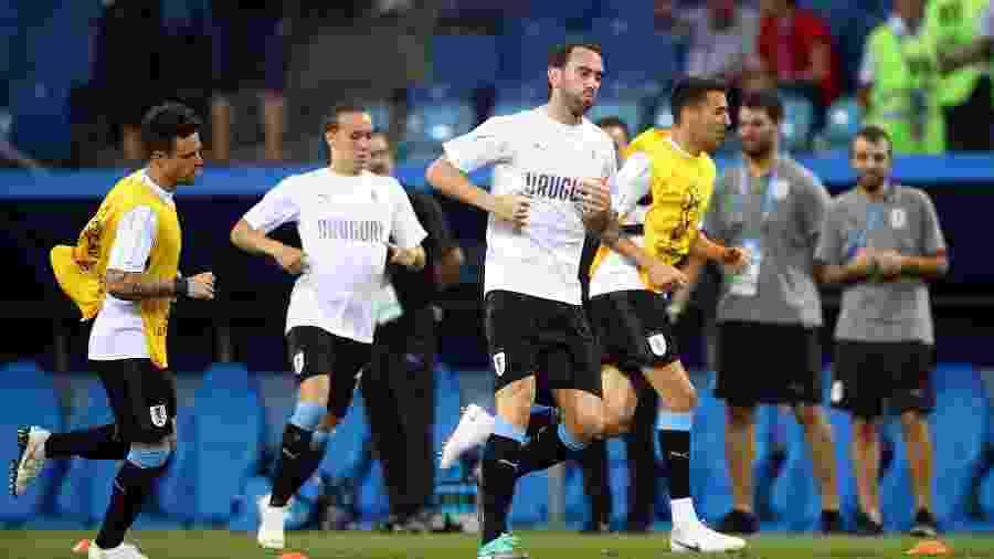 Jogadores do Uruguai durante o aquecimento para a partida contra Portugal - REUTERS/Hannah Mckay