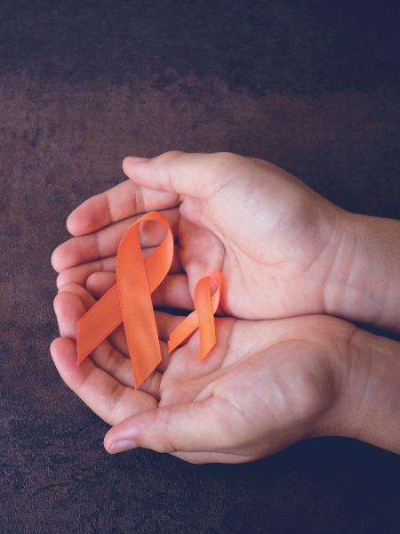 Fita laranja: cor da Conscientização da Esclerose Múltipla  - iStock