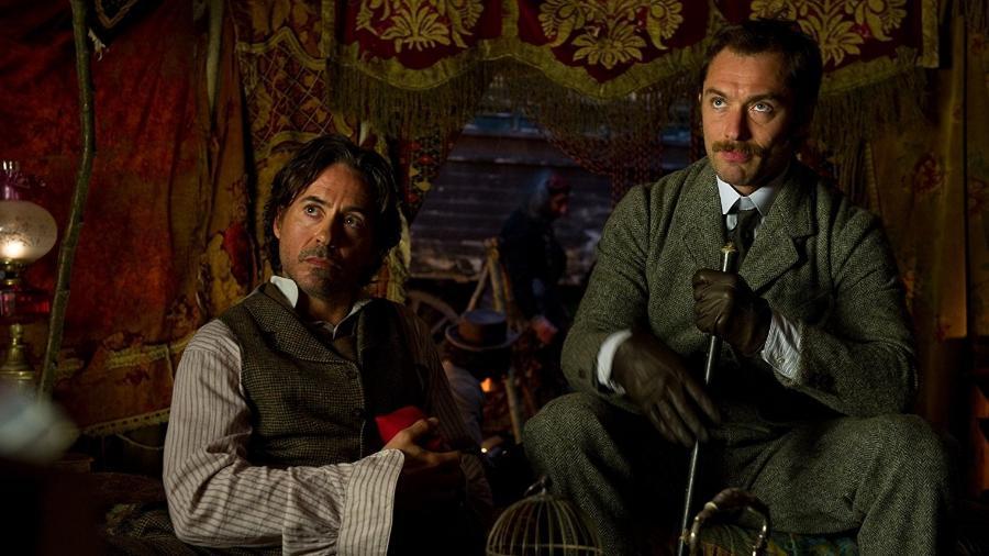 "Robert Downey Jr. e Jude Law como Sherlock Holmes e Dr. Watson em cena de ""Sherlock Holmes: O Jogo de Sombras"" (2011) - Christopher Raphael/Warner Bros. Entertainment Inc"