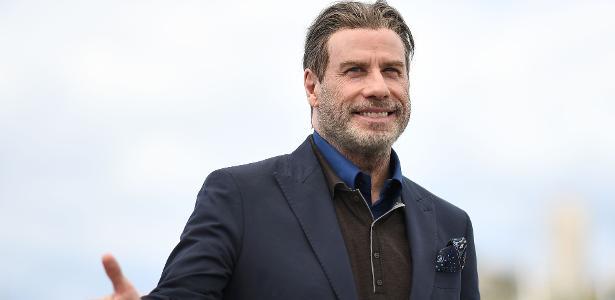 John Travolta posa para fotógrafos no Festival de Cannes
