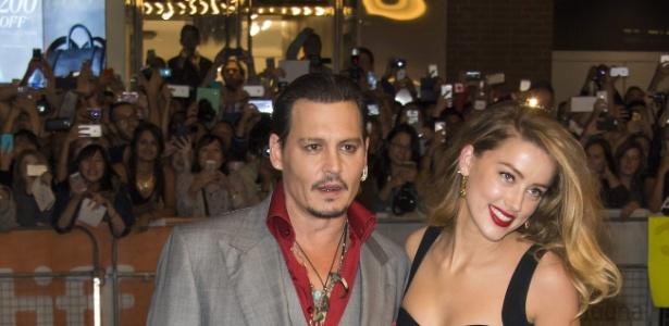 O ator Johnny Depp e a mulher, a atriz Amber Heard, tiveram problemas na Austrália - Warren Toda /EFE