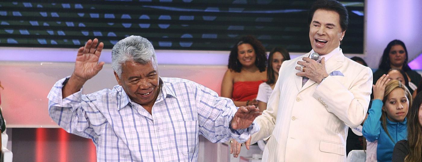 2011 - Silvio Santos e Roque no meio do auditório de seu programa no SBT - Divulgação/SBT