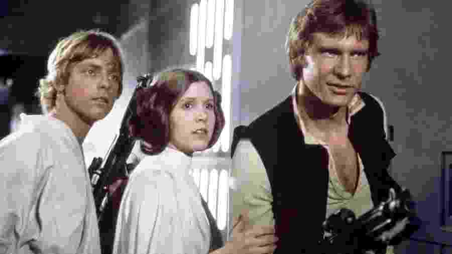 """Harrison Ford, Carrie Fisher e Mark Hamill em """"Star Wars: Uma Nova Esperança"""" (1977) - Divulgação"""