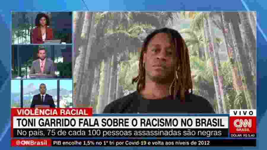 Cassius Zeilmann, da CNN Brasil, chorou após ouvir fala de Toni Garrido sobre racismo - Reprodução/CNN Brasil