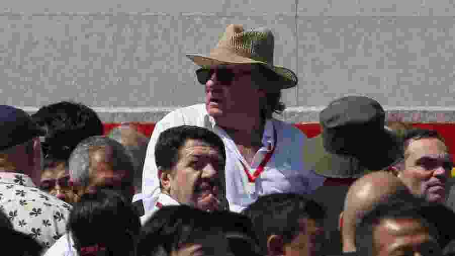 Gérard Depardieu assiste ao desfile militar na comemoração do aniversário da Coreia do Norte - Sebastien BERGER / AFP
