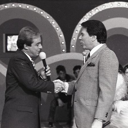 """Gugu com Silvio Santos no """"Roletrando"""" em 1988 - Moacyr dos Santos/SBT"""
