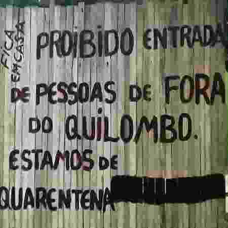 Cartaz na entrada do quilombo Pitimandeua, em Inhangapi (PA) - Malungu/Divulgação