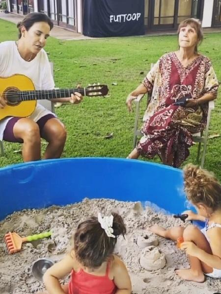 Ivete Sangalo toca violão e canta para tia e filhas gêmeas