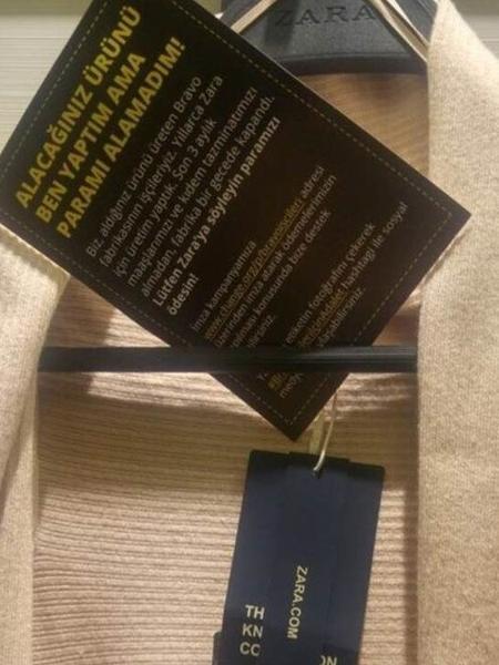 """Imagem mostra produto da Zara com a etiqueta """"Eu fiz este item que você vai comprar, mas não fui pago por isso!"""" - Reprodução/BBC"""