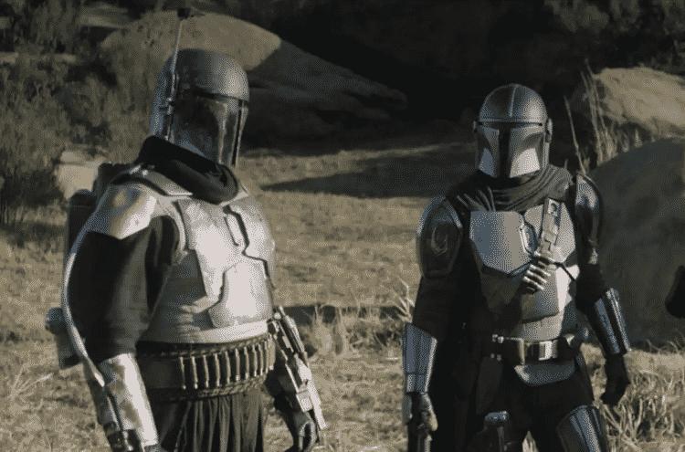 Boba Fett ao lado do protagonista de 'The Mandalorian' em cena do episódio 'The Tragedy' - Reprodução - Reprodução