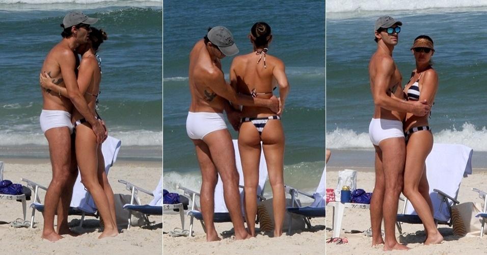 """15.ago.2015 - Neste sábado de sol, Giba e Maria Luiza Daudt namoram em praia da Barra da Tijuca, no Rio de Janeiro. Entre abraços e beijinhos, ele dá um """"confere"""" no bumbum da mulher"""