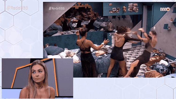 Paula assiste momento em que foi empurrada por Hariany - Reprodução/GloboPlay