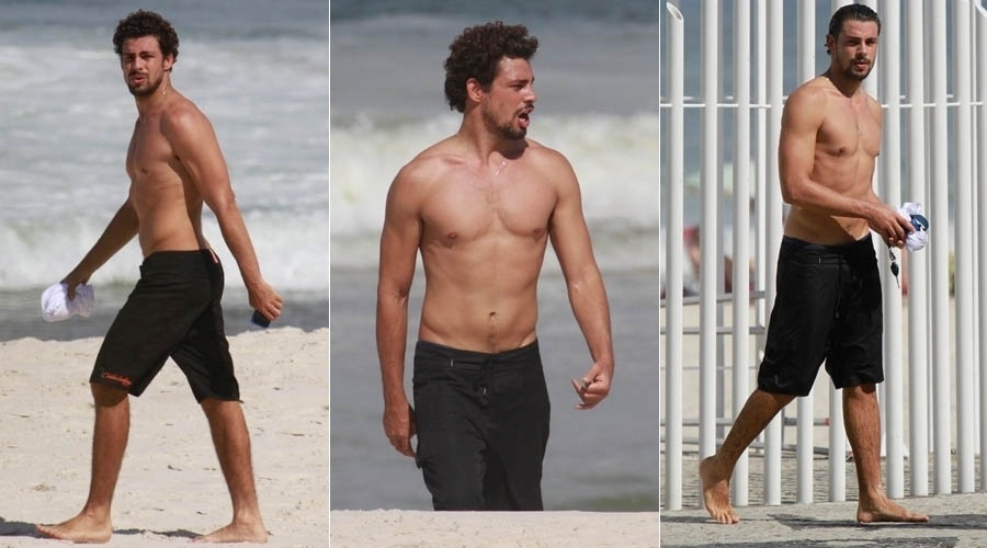 28.mai.2013 - Com o cabelo grande, Cauã Reymond é fotografado na praia da Barra