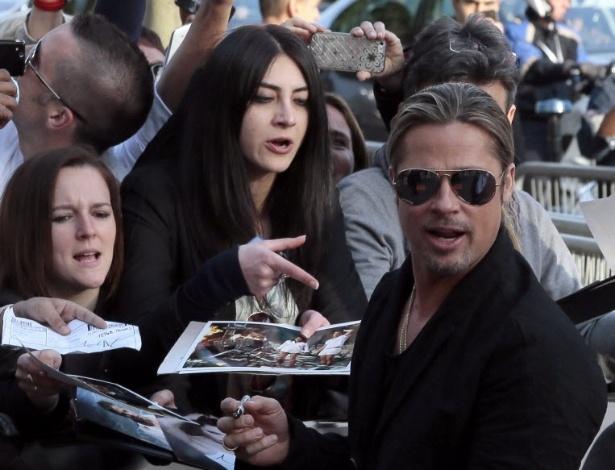 3.jun.2013 - Brad Pitt na pré-estreia parisiense de