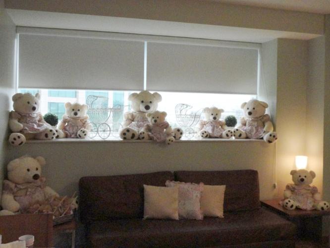 Ursos de pelúcia e carrinhos de ferro fazem parte da decoração deste quarto de maternidade. Serviço prestado pela empresa carioca Julubeca