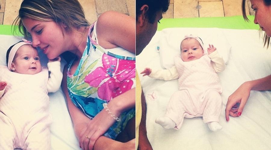 """14.jul.2013 - Debby Lagranha só pensa em paparicar a filha Maria Eduarda. A atriz divulgou uma imagem onde aparece ao lado da bebê. """"Meu maior prazer"""", escreveu ela"""