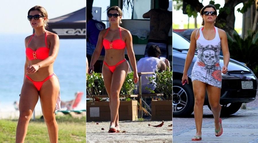 18.jul.2013 - A panicat Babi Rossi caminhou pela orla da praia da Barra da Tijuca, zona oeste do Rio, nesta quinta (18). A modelo chamou atenção por vestir um biquíni de cor flúor