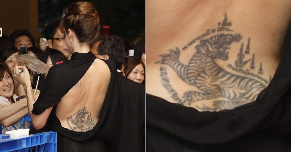 Angelina Jolie fez a tatuagem do tigre na parte inferior das costas com o mestre tailandês Sompong Kanphani no dia 8 de julho de 2004. O desenho foi feito da maneira tradicional tailandesa, com uma agulha manual. A atriz viajou para o país especialmente para fazer o desenho, que tem 20 cm de largura e 30 cm de comprimento, e demorou duas horas para ser feita