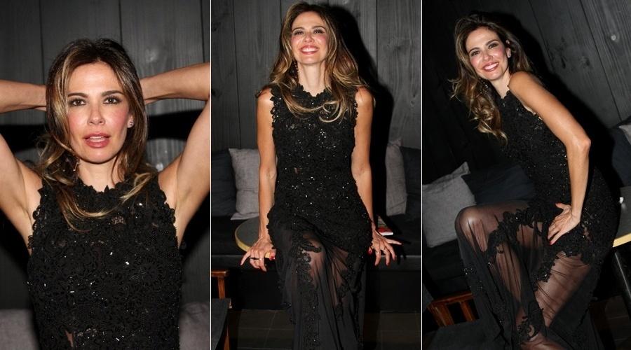 12.set.2013 - Luciana Gimenez fez caras e bocas para os paparazzi no lançamento do seu ensaio para a edição de setembro da revista