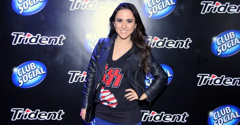 13.set.2013 - A atriz Tatá Werneck posa ao chegar a um dos camarotes no primeiro dia do Rock in Rio