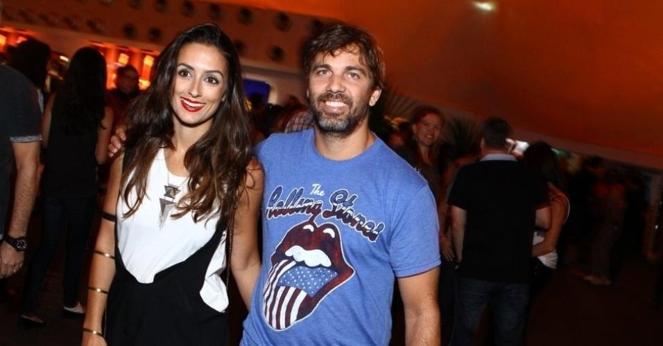 13.set.2013 - O ator Marcelo Faria e a mulher, a atriz  Camila Lucciola, no Rock in Rio