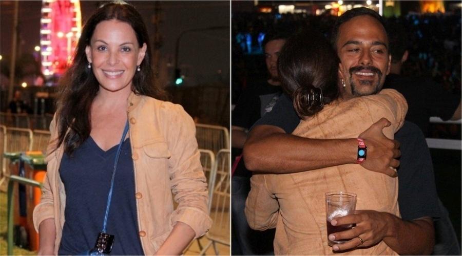 A atriz Carolina Ferraz curte a quarta noite de shows do Rock in Rio 2013. Seu namorado, o médico Marcelo Martins, se irritou ao ser deixado de lado quando a atriz parou para conversar com a imprensa