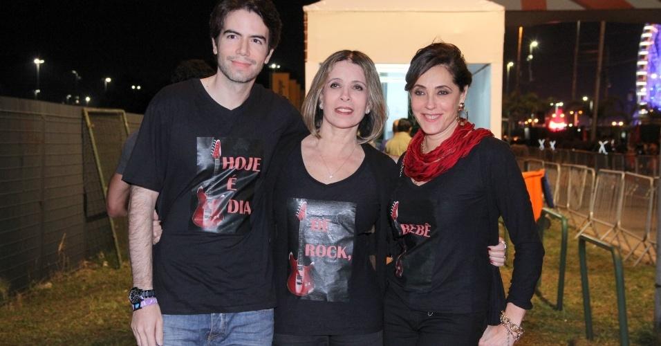 21.set.2013 - Acompanhada por seus assessores, Liége Monteiro e Luiz Fernando Coutinho, Christiane Torloni volta ao Rock in Rio