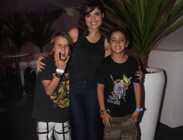 22.set.2013 - Vanessa Giácomo prestigiou o último dia de Rock in Rio, ao lado do namorado, Giuseppe Dioguardi, e os sobrinhos dele, Tomás e Felipe, ambos de 10 anos de idade