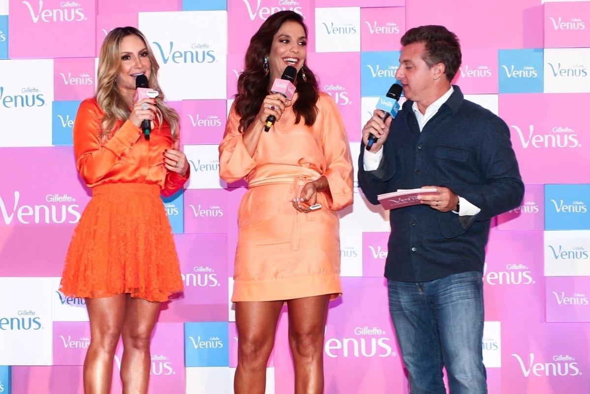 9.out.2013 - Claudia Leitte, Ivete Sangalo e Luciano Huck participam do lançamento de campanha de um produto de beleza, em São Paulo