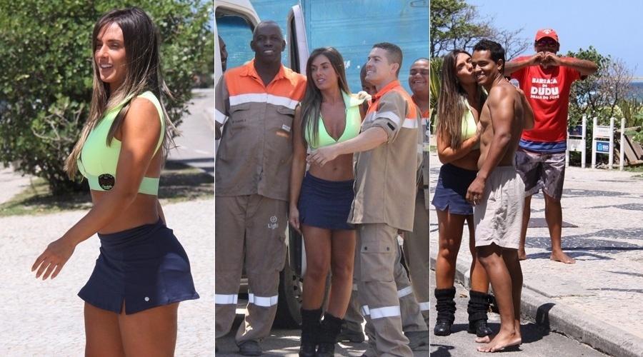 """9.out.2013 - Nicole Bahls foi tietada durante dia de treino pela orla da praia da Barra da Tijuca, no Rio. A repórter do """"Pânico da Band"""" tirou fotos com trabalhadores que estavam por perto"""