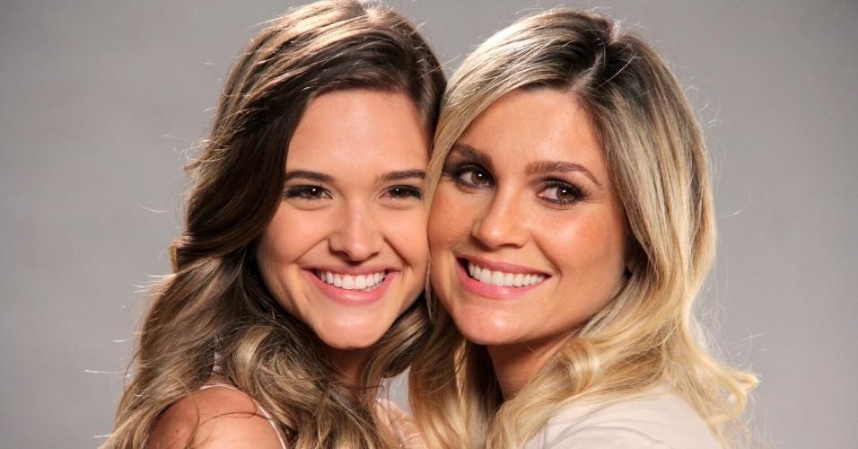 """15.out.2013 - Juliana Paiva e Flávia Alessandra se abraçam durante o lançamento de """"Além do Horizonte"""", no Rio Janeiro"""
